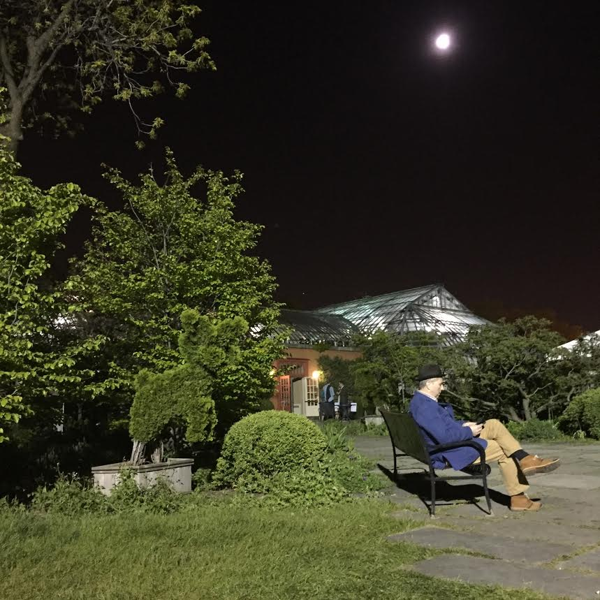 Garfield Park Conservatory at night with moon